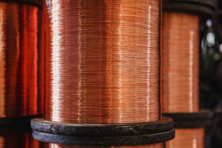 Production of copper wire, bronze cable in reels at factory.