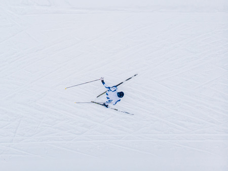 Skier cross-country skiing in snow forest. Concept of winter sports. Aerial top view.