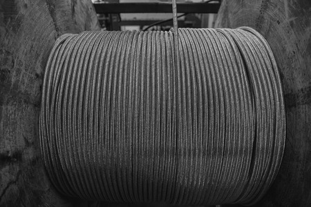 Steel wire, aluminum on reels in the industrial production for metalworking. Stock Photo