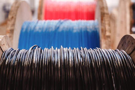 Steel wire, aluminum on reels in the industrial production for metalworking. 版權商用圖片