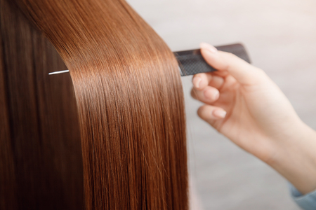 Saturated healthy shiny hair after dyeing. Concept of recovery structure. Stock Photo