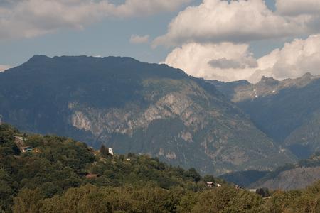 Dawn Alps mountains France, snowy peaks in fog, summer. Reklamní fotografie