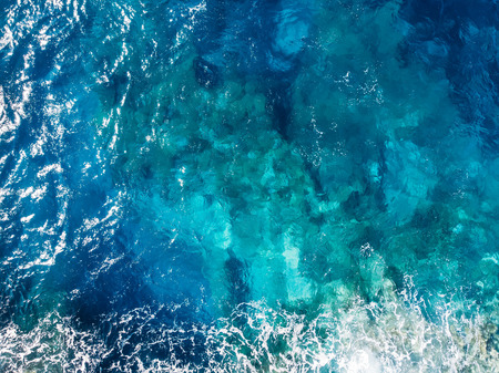 Raging blue water of open Mediterranean Sea with turquoise bottom. top view Stockfoto
