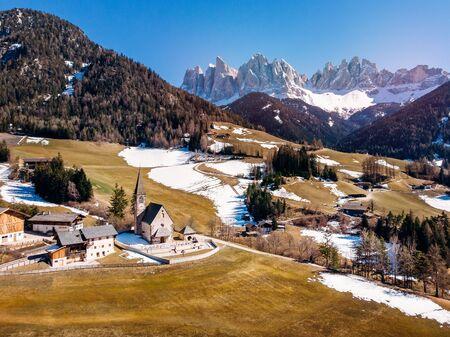 Alps mountain Santa Maddalena village with Dolomites in background, Trentino Alto Adige region, Funes valley, Italy.