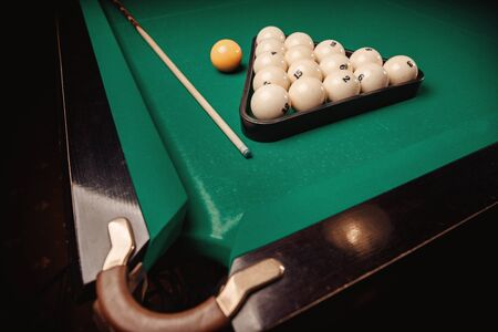 Billiard Russian green table and cue with white balls Stock Photo