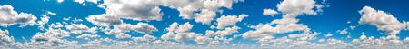 Panoramic photo background of blue sky with thick clouds