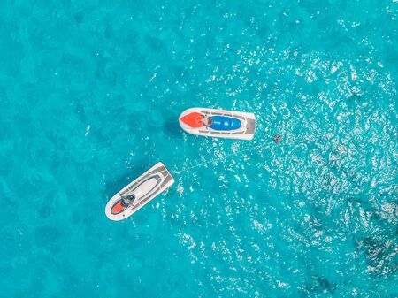 Jet skis for rent are parked in blue lagoon tropical sapphire, aerial top view Reklamní fotografie