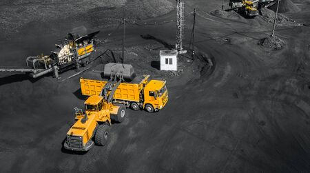 Open pit mine, coal loading in trucks, transportation and logistics, top view aerial drone 写真素材