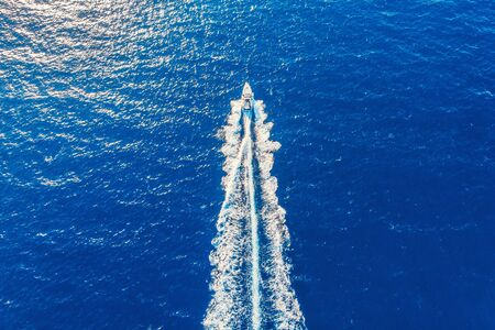 Speed boat in motion. Summer leisure time activity. Aerial top view