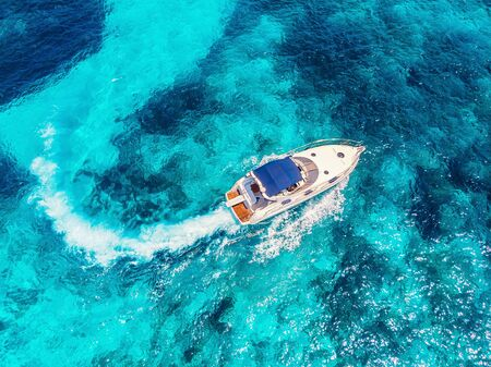 Luxury speed motor boat. Clear blue turquoise water. Aerial view