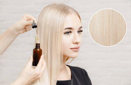 Master hairdresser procedure oil hair treatment for woman. Concept spa salon.