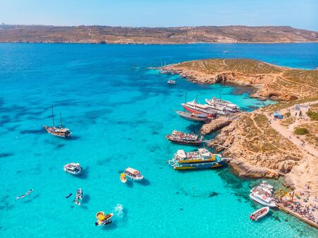 Panorama of Blue Lagoon Comino Malta. Cote Azur, turquoise clear water with white sand. Aerial view
