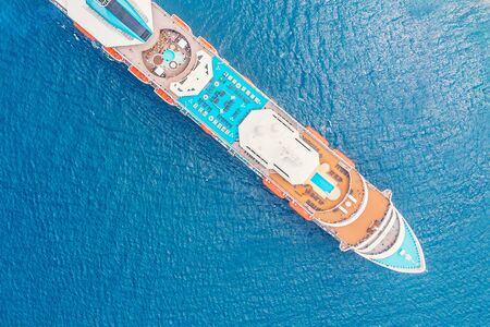 Cruise ship in blue sea. Aerial view photo