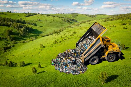 Garbage truck dumps plastic waste and packages onto clean green field. Concept pollution of environment, man poisons earth