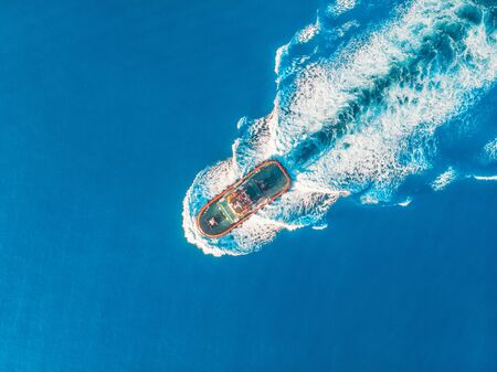 Tugboat blue sea port. Aerial top view Stock Photo