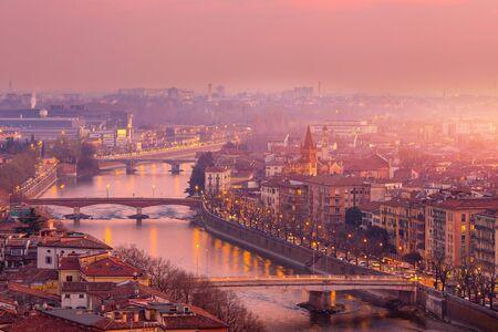 Beautiful aerial view panorama Verona bridge over river sunset, Veneto region, Italy