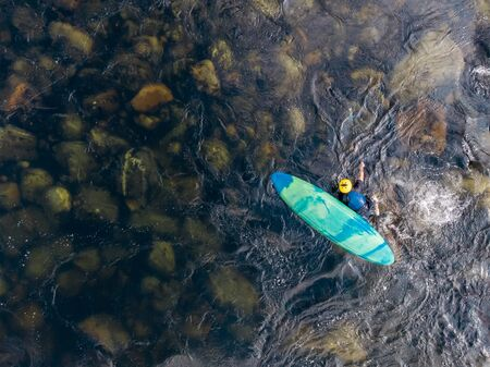 Extreme athlete rolled over on kayak in mountain river