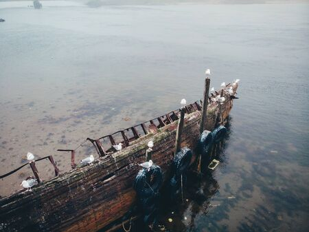 Cemetery of old ships in Teriberka Murmansk Russia, dramatic photo. Aerial top view Stock Photo