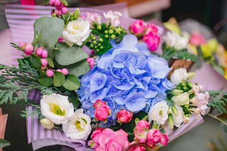Colorful bright bouquets red, pink, blue, green, yellow colour from flowers of roses, chrysanthemums, eucalyptus, orchids