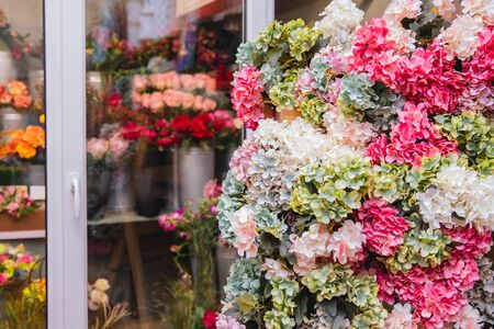 Banner florist shop, closeup luxurious flowers bouquet, in background fridge storage