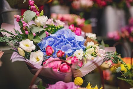 Colorful bright bouquets red, pink, blue, green, yellow colour from flowers of roses, chrysanthemums, eucalyptus orchids Zdjęcie Seryjne