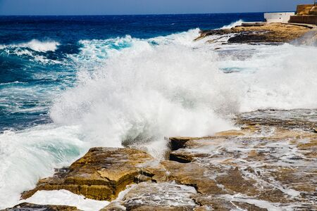 Natural background storm sea blue ocean with foam and waves. Banco de Imagens