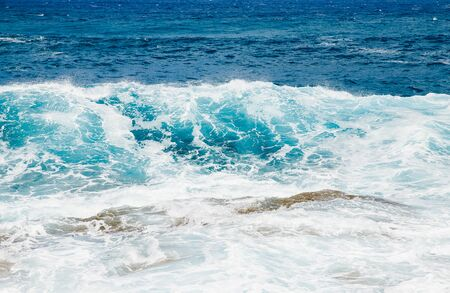Natural background blue sea with waves, azure clear water beach.