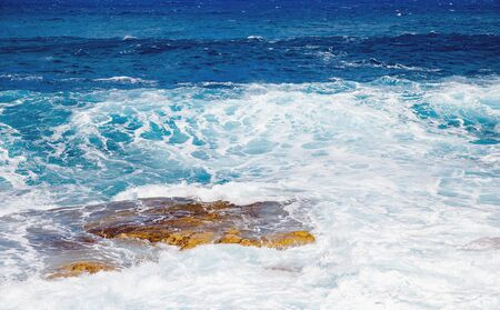 Natural background blue sea with waves, azure clear water beach. Banco de Imagens - 132125764