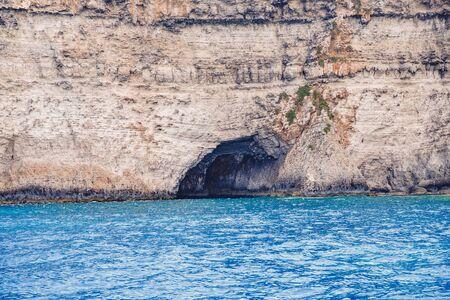 Panorama beach Blue Lagoon Comino Malta. Rocky coast with window and arch Mediterranean Sea. Stock fotó