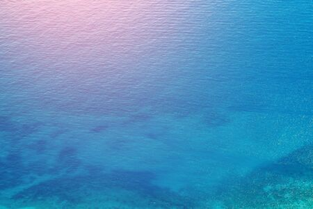 Background tropical blue clear transparent turquoise sea water, sunny weather. Stock Photo