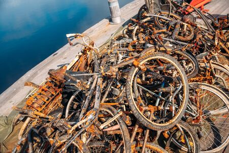 Pile of rusty bicycles got out water, cleaning rivers and canals of Amsterdam from bike debris