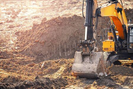 Loader excavator during earthmoving works removes overburden of soil. Concept open mine. Stok Fotoğraf