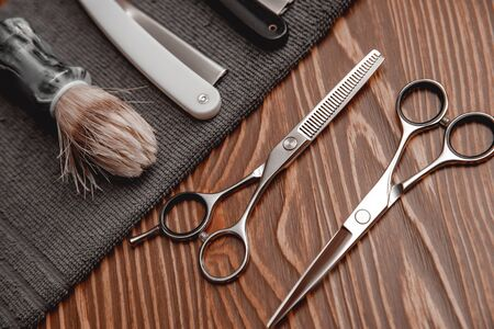 Barber shop background for men beauty salon, hairdresser tools scissors, razor, comb, copy space.