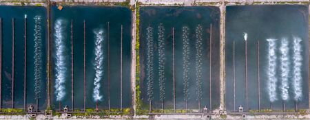 Pond cooler sprinkler system for condensation steam of water thermal power plants. Aerial view