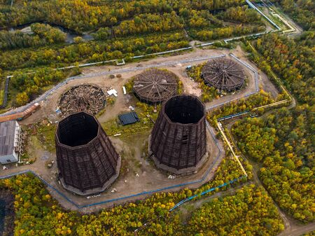 Cooling tower dismantling old system for condensation steam of water thermal power plants. Aerial view