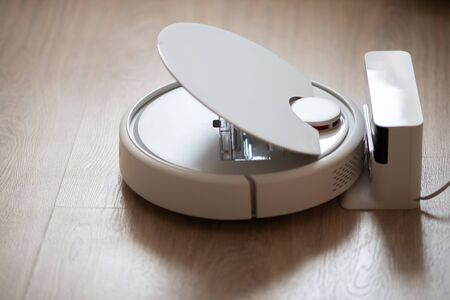 Robotic wireless smart vacuum cleaner stands base of charging.