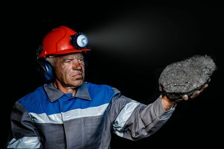 Miner after working on coal mine. Concept industrial engineer