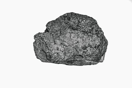 Pieces black coal lie on white isolated background, copy space Imagens