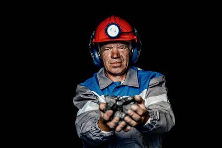 Portrait miner coal man in helmet with lantern in underground mine. Concept industrial engineer 写真素材