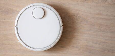 Robotic wireless smart vacuum cleaner working on laminate flooring