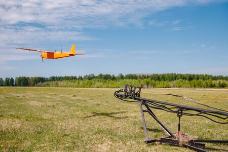 Launch RC hybrid aircraft model of electricity gasoline for mapping agriculture and people search.