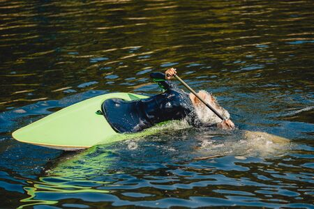 Extreme trick on kayak in mountain river eskimo coup.