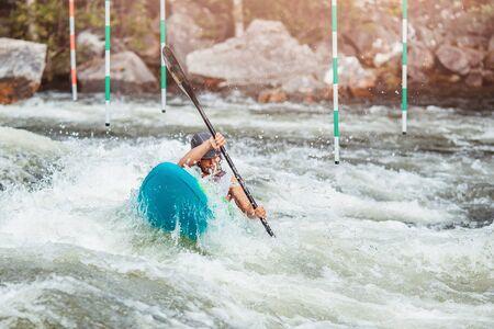 Guy in kayak sails mountain river. Whitewater kayaking, extreme sport rafting. 写真素材 - 132454907
