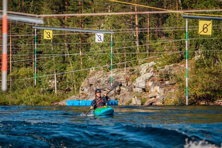 Kayak man runs extreme sports track in mountain river.