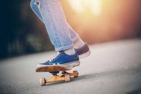 Skateboard man practices to ride on asphalt, learns tricks.