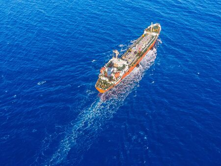 Oil chemical tanker sails blue sea. Aerial top view