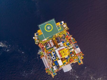 Offshore oil rig Installation of equipment sea, aerial top view Stock Photo