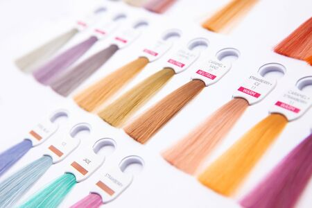 Hair palette dyed different colors. Hairstyle wig tints set for beauty industry.