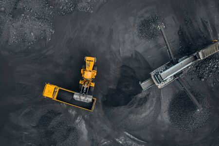 Open pit mine, extractive industry for coal, top view aerial drone. Banco de Imagens