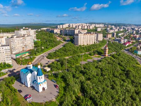 Murmansk, Russia - Aerial view memorial Lighthouse, church and anchor monuments, Panorama northern city. Cargo Port gulf of sea